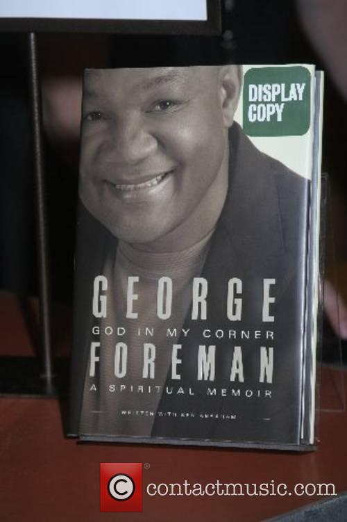 George Foreman signs his new book