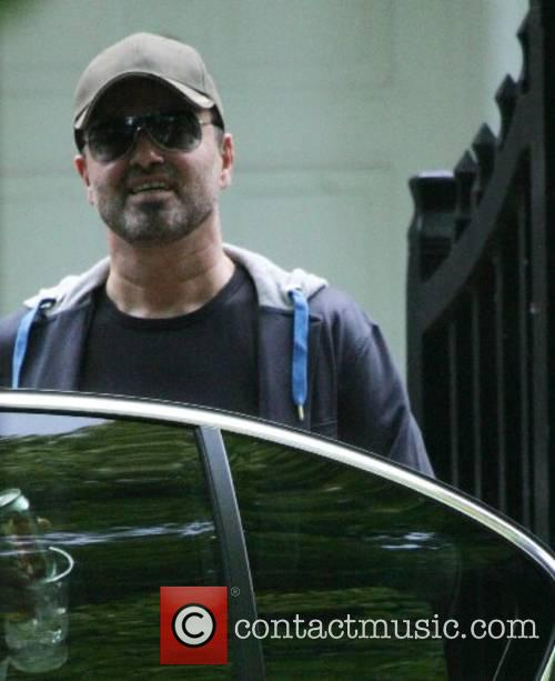 George Michael leaving his home with his manager...
