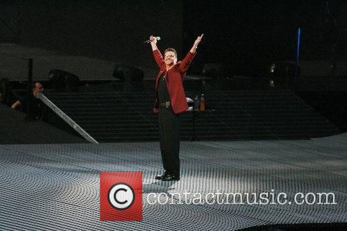 George Michael performing in concert at the opening...