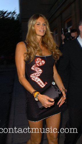 Elle Macpherson leaving George Michael's 44th birthday party...