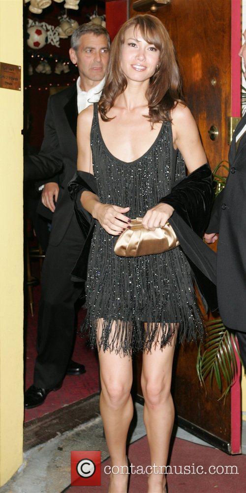 George Clooney and Sarah Larson leaving Dan Tanas...