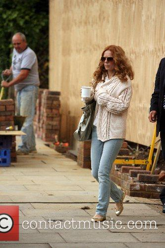 Geri Halliwell inspects building work going on outside...