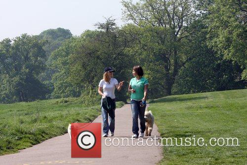 Geri Halliwell takes her dog for a walk...