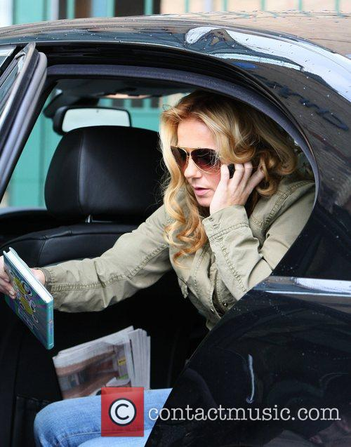 Arrives at LBC radio station holding her new...