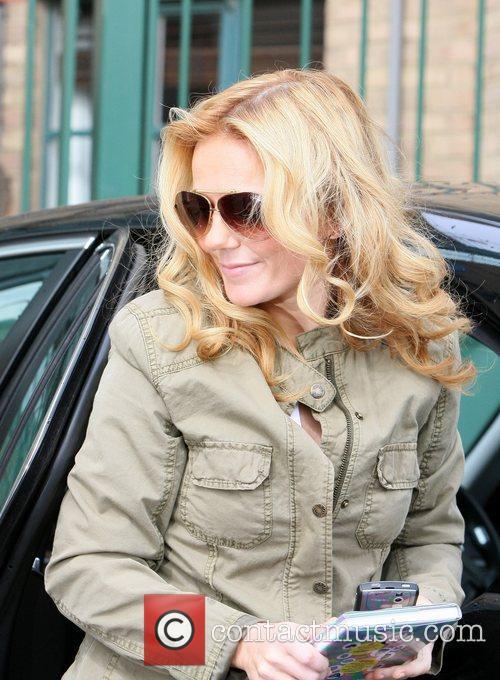 Geri Halliwell arrives at LBC radio station holding...