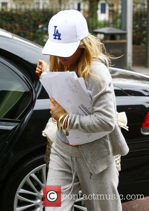 Geri Halliwell arriving at a recording studio holding...
