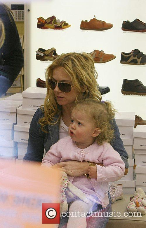 Geri Halliwell in''Cubs Shoe Shop' with her daughter...