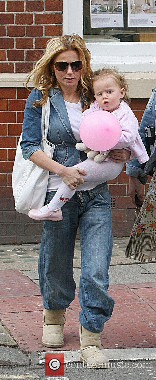 Holding her daughter Bluebell after shopping at 'Cubs...