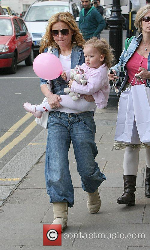 Geri Halliwell holding her daughter Bluebell after shopping...
