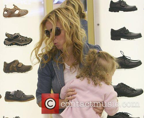 Geri Halliwell holding her daughter Bluebell while shopping...