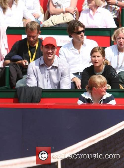 Wladimir Klitschko watching the tennis match between Roger...