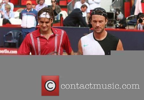 Roger Federer (left) after he defeated Carlos Moya...