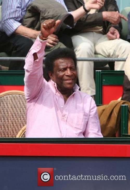 Roberto Blanco watching the tennis match between Roger...