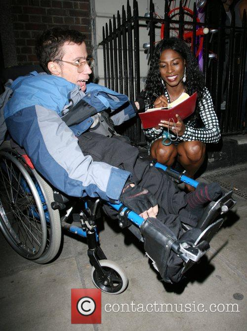 Sinitta  signs a autograph for a disabled...