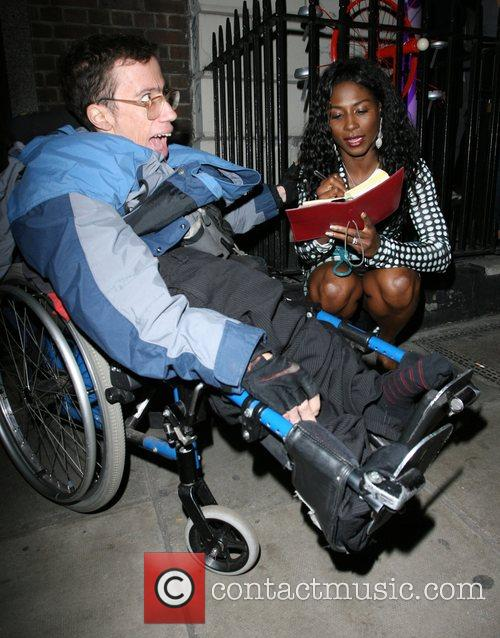 Sinitta  signs an autograph for a disabled...