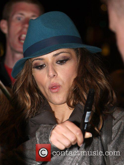 Girls Aloud greet fans and sign autographs as...