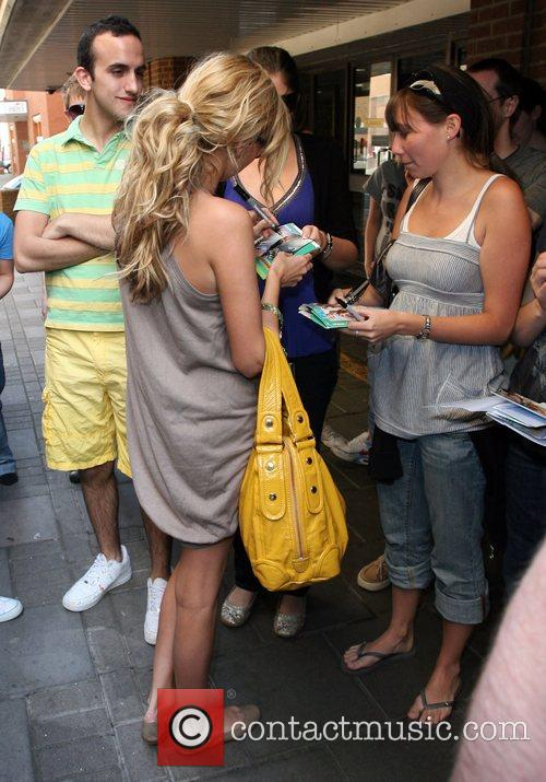 Nadine Coyle  signs autographs for waiting fans...