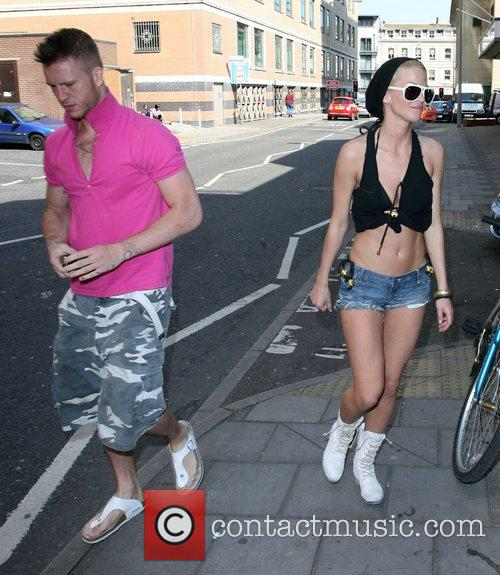 Sarah Harding  tries to avoid being photographed...