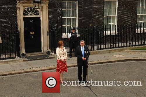Britain's new Prime Minister Gordon Brown holds a...