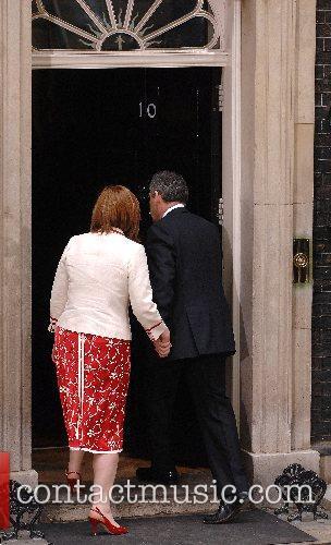 Britain's new Prime Minister Gordon Brown enters 10...