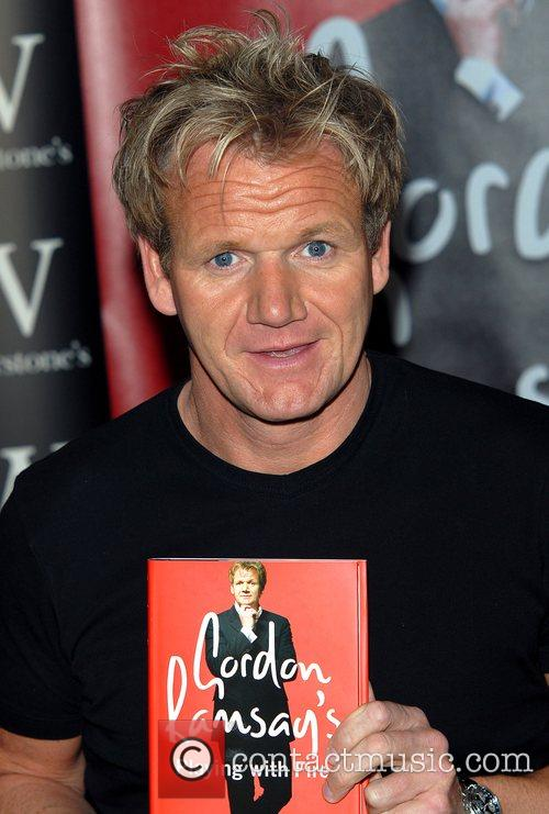 Gordan Ramsay greets fans and signs copies of...