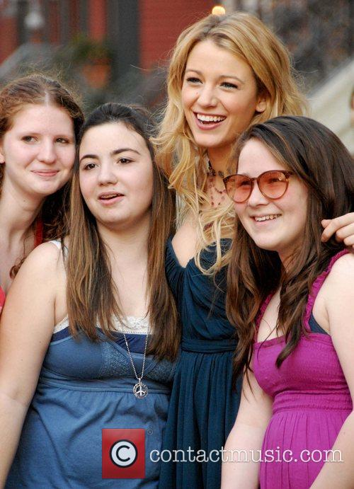 Blake Lively posing with fans on the set...