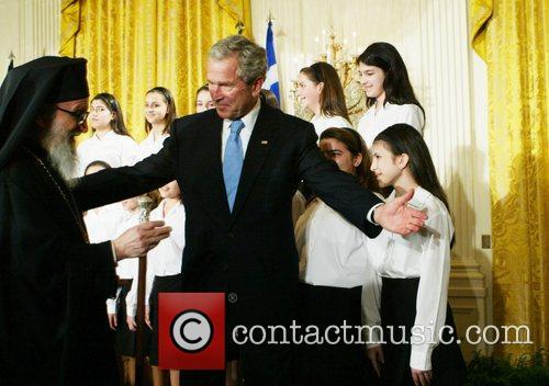 president george bush greeting members of the greek orthodox community to celebrate greek independence day. 5108376