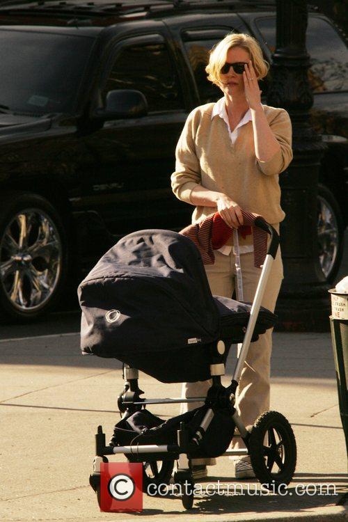 Gretchen Mol walking a pram around the streets...