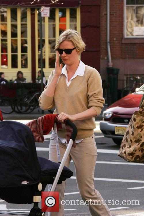Gretchen Mol walking a pram around the streets...