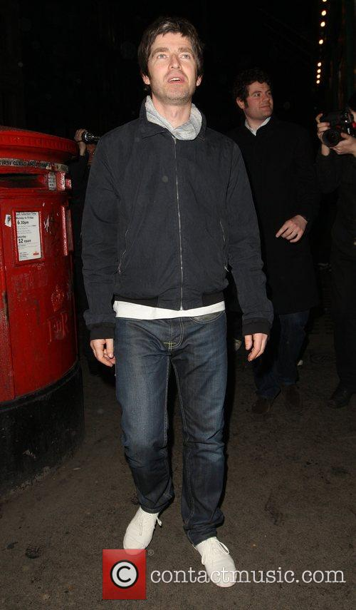 Noel Gallagher at the Groucho club joking with...