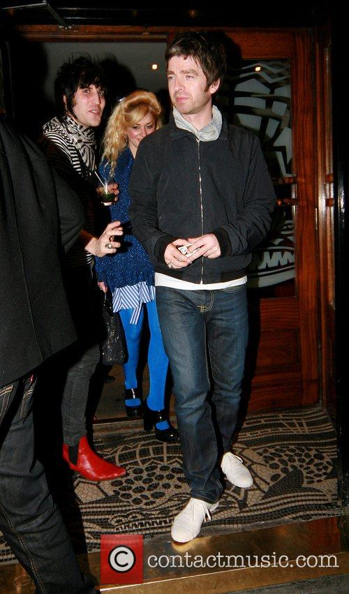 Noel Fielding and Noel Gallagher leaving the Groucho...