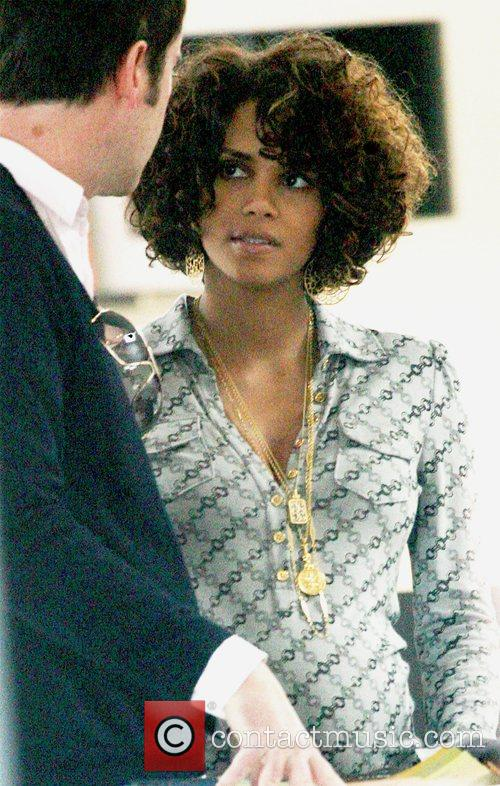 Halle Berry showing off her growing baby bump...