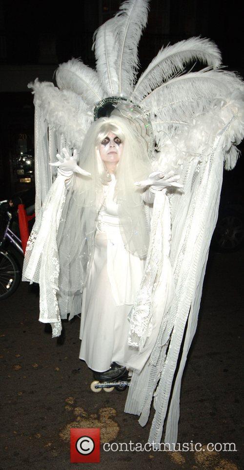 Halloween Revellers Dressed As Ghosts 8