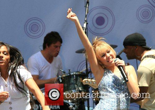 Hannah Montana Hannah Montana and Miley Cyrus performing...