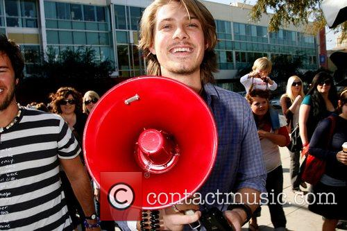 Taylor Hanson with Blake Mycoskie of Toms Shoes...