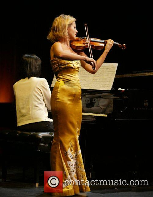 Violinist Anne-Sophie Mutter performing at the opening gala...