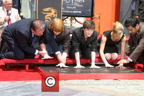 Rupert Grint, Daniel Radcliffe, and Emma Watson Harry...