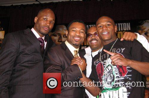 Floyd Mayweather (r) with Golden Boy Promoters and...