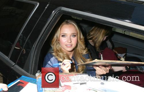 Stops to sign autographs as she leaves the...