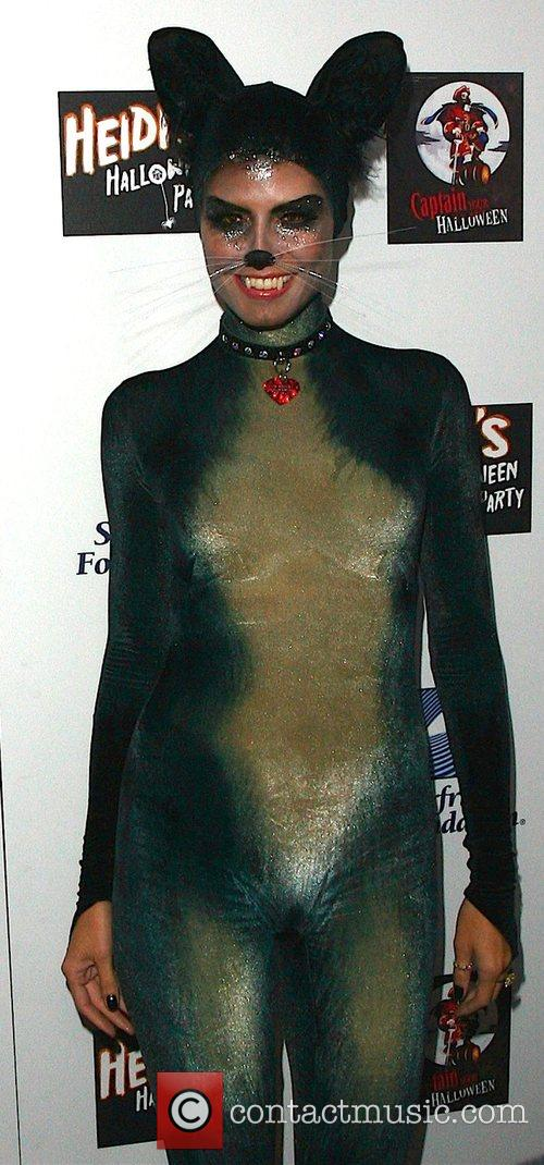 Heidi Klum dressed as a cat for her...