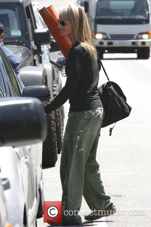 Helen Hunt carrying a yoga mat after her...