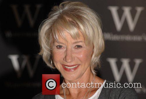 Helen Mirren  signs copies of her book...
