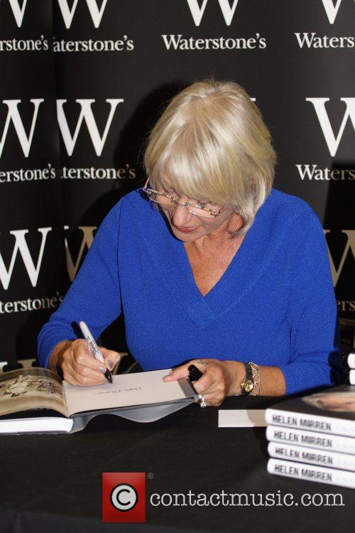 Signs copies of her book 'In The Frame'...