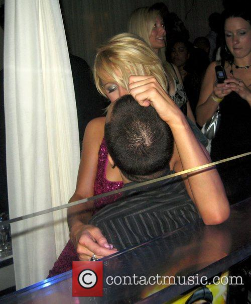 Paris Hilton  getting intimate with a mystery...