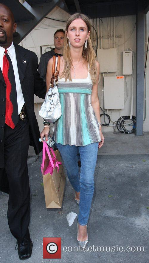 Nicky Hilton leaving by the back door after...