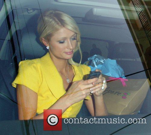 Paris Hilton waits in her car for boyfriend...