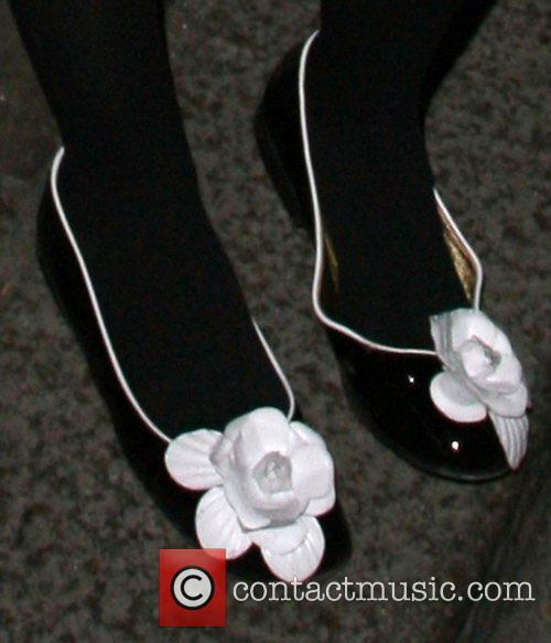 Lady Victoria Hervey wearing shoes with white rose...
