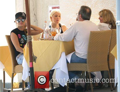 Playboy playmate Holly Madison eating lunch at a...