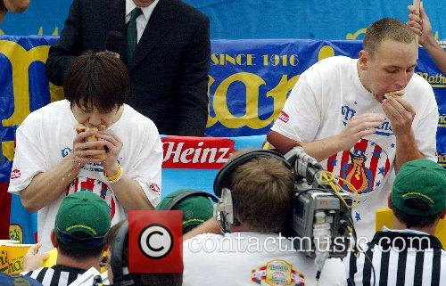 Joey Chestnut, right, of San Jose, USA defeated...