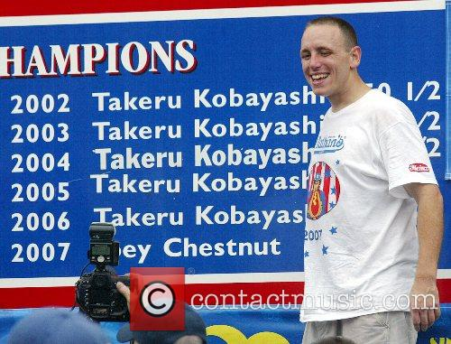 Joey Chestnut of San Jose who defeated six...
